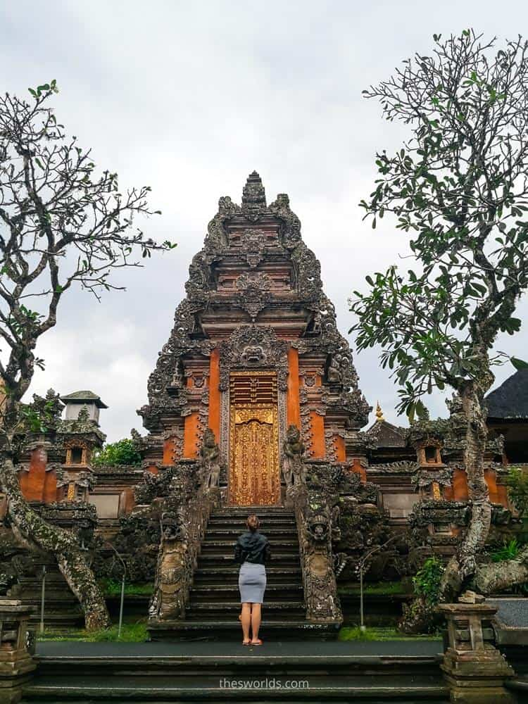 Girl standing and looking at Saraswati temple in Ubud