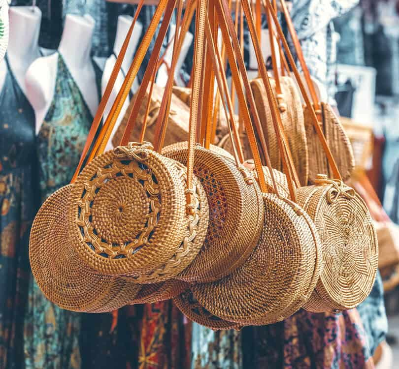 Balinese straw bags with dresses in the background