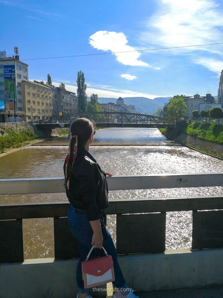 Girl looking at Skenderija Bridge in Sarajevo