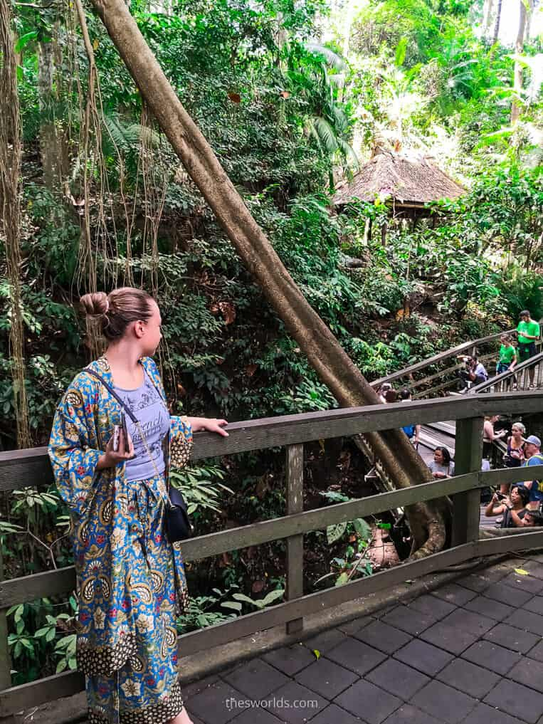 Girl looking at people walking in Ubud monkey forest