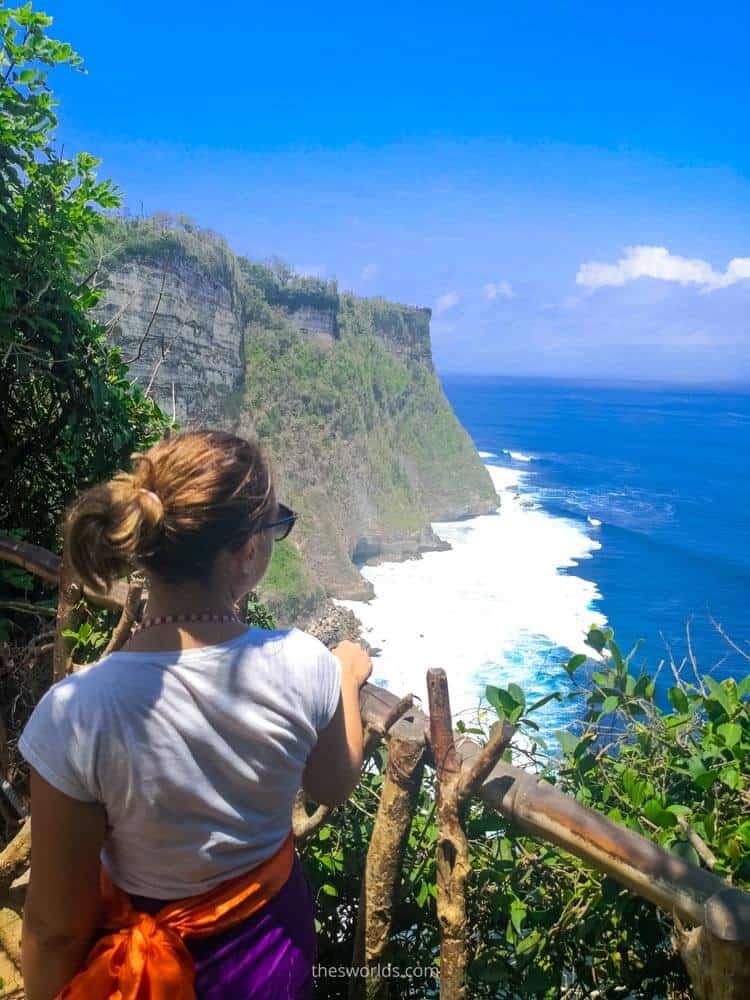 Girl looking at ocean from Uluwatu temple in Bali