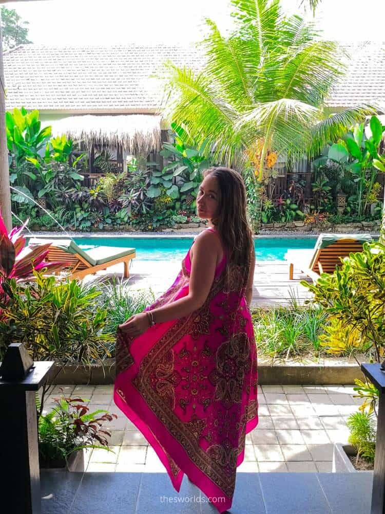 Girl standing at entrance to villa in Ubud with pool in the background