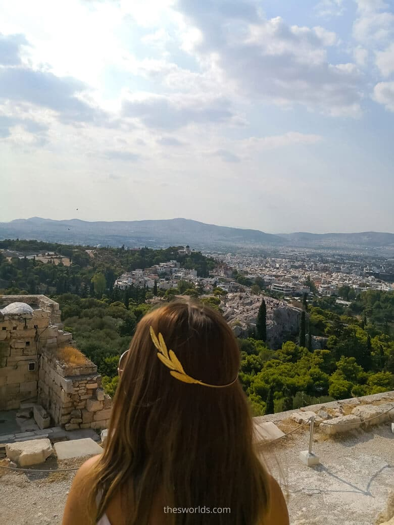 Girl overlooking Athens city center in Summer