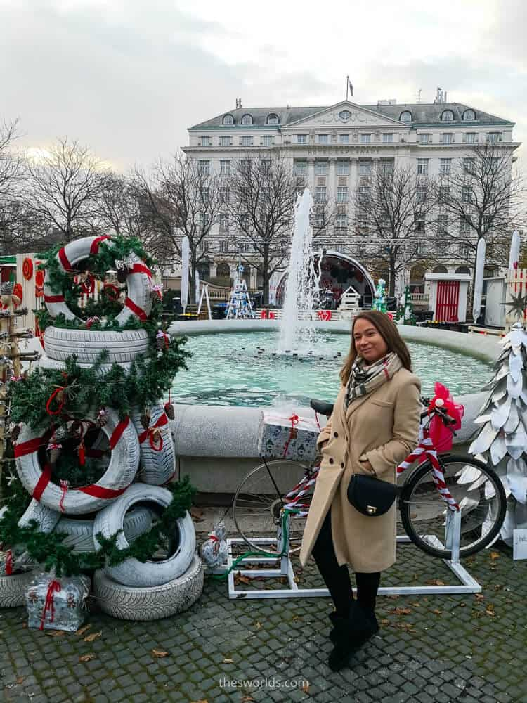 Girl standing in front of Christmas decorated fountain in Zagreb