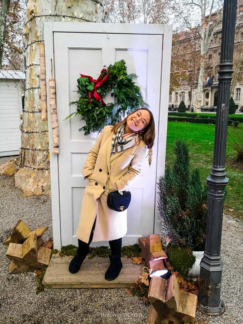 Girl posing in front of door outside in Zagreb
