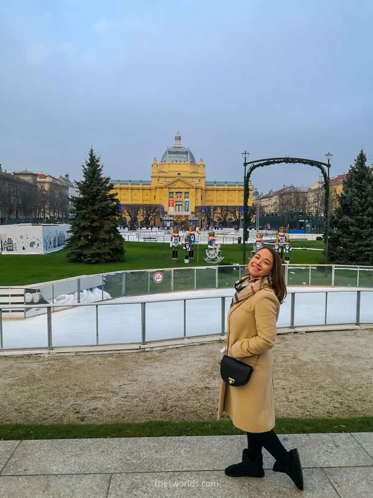 Girl posing next to ice skiing rink in Zagreb