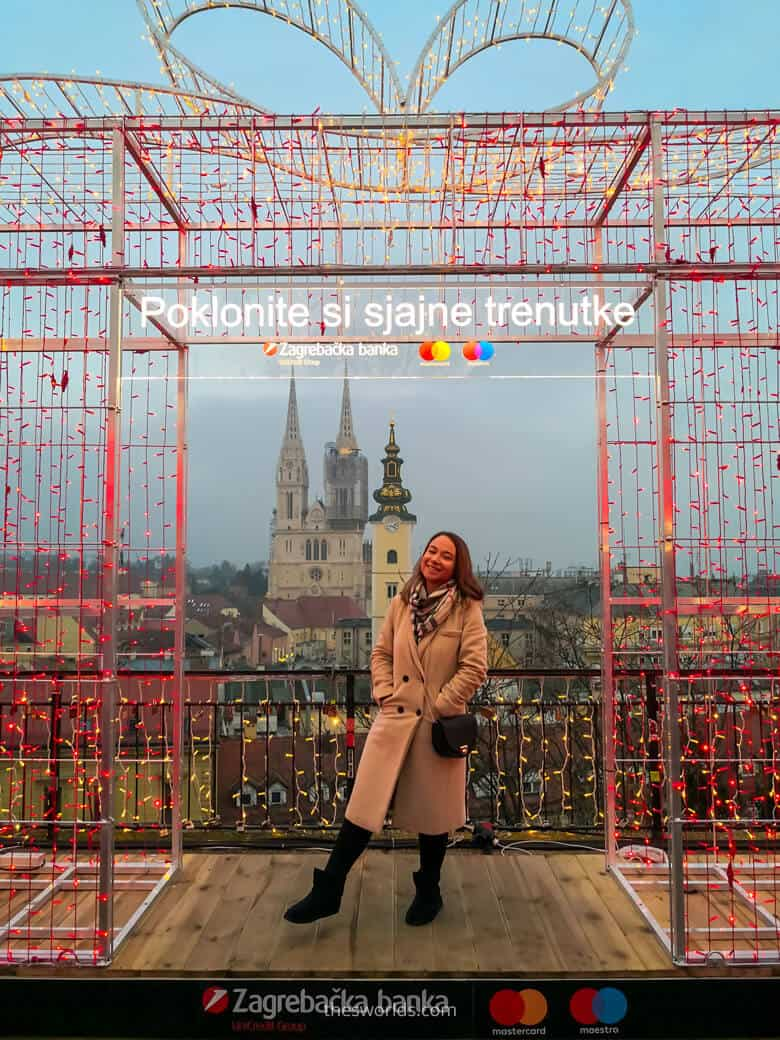 Girl posing on a Balcony looking at Zagreb Cathedral