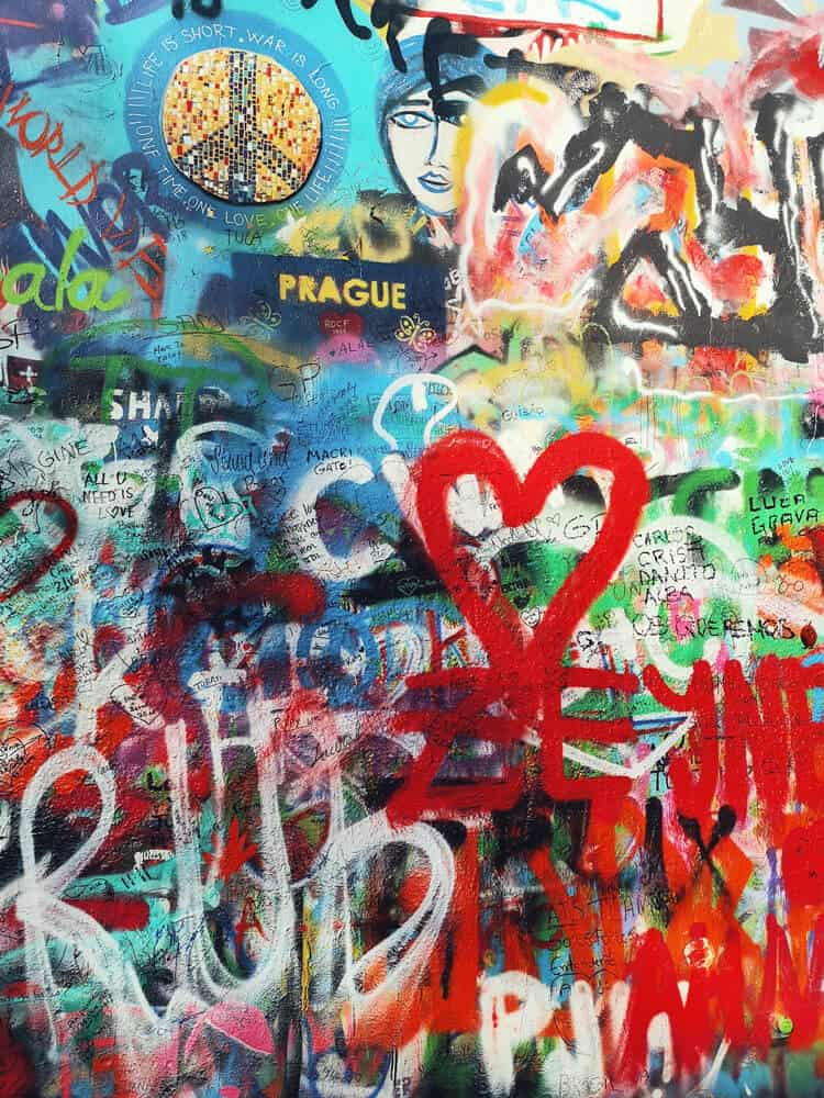 Paintings of things at John lennon wall in Prague