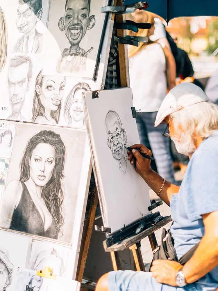 Man drawing people in Prague
