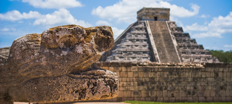 Mayan statue and temple in Mexico