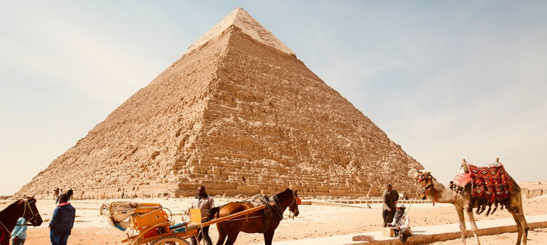 People in front of pyramids in Egypt