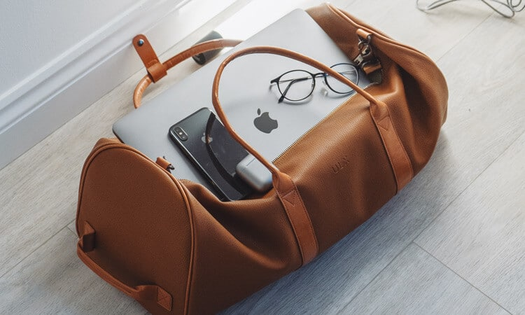 Bag with laptop and glasses