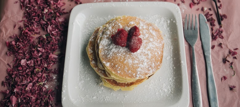 Pancakes with berries on tray