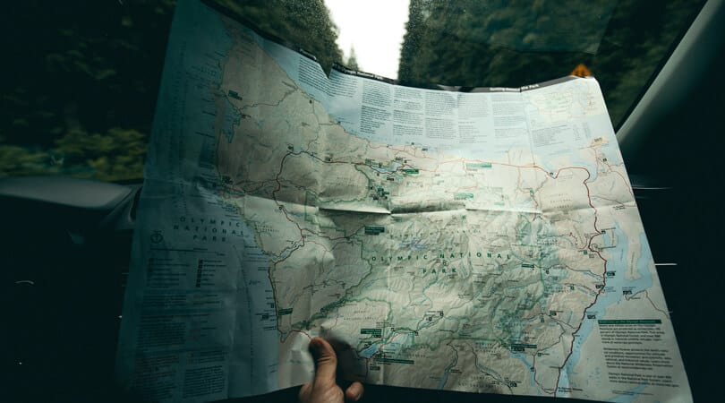 Person looking at a map in car of Olympic national park Washington