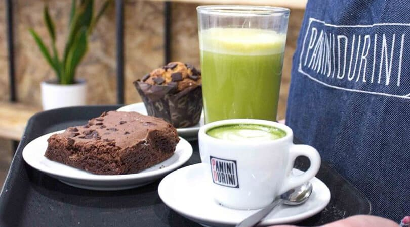 Muffin and brownie with coffee and juice at Panini Durini Milan