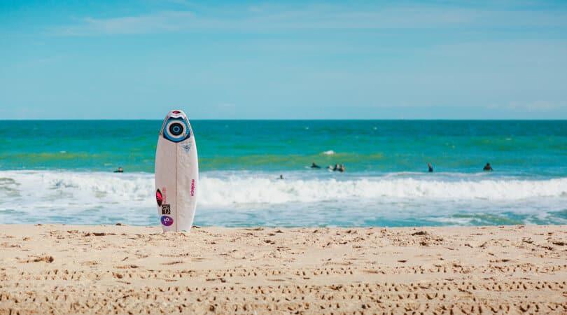 Surfing board on a sand beach