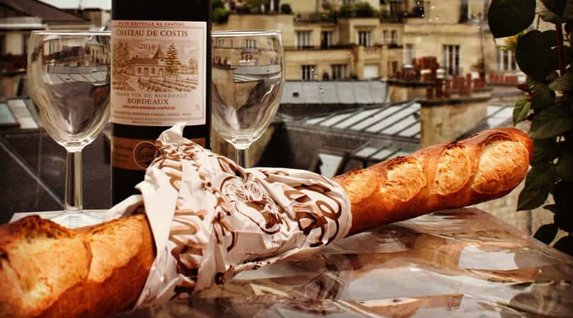 Baguette with wine and glasses in France