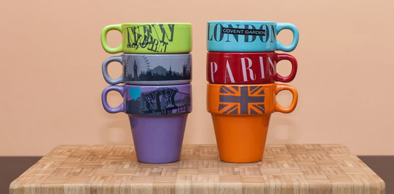 Decorated mugs with city names