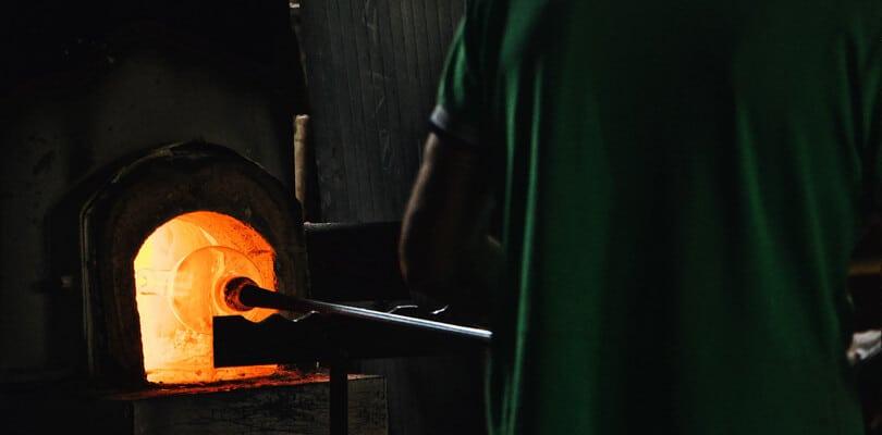 Person forging glass