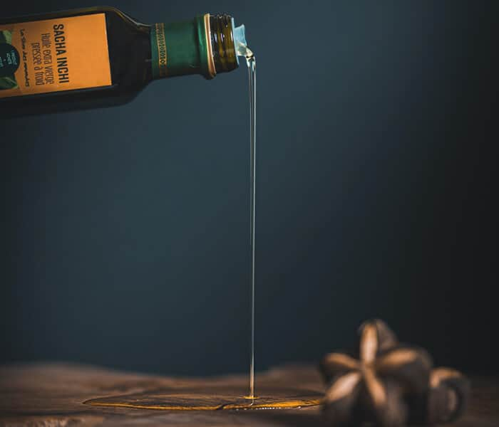 Pouring olive oil on Table
