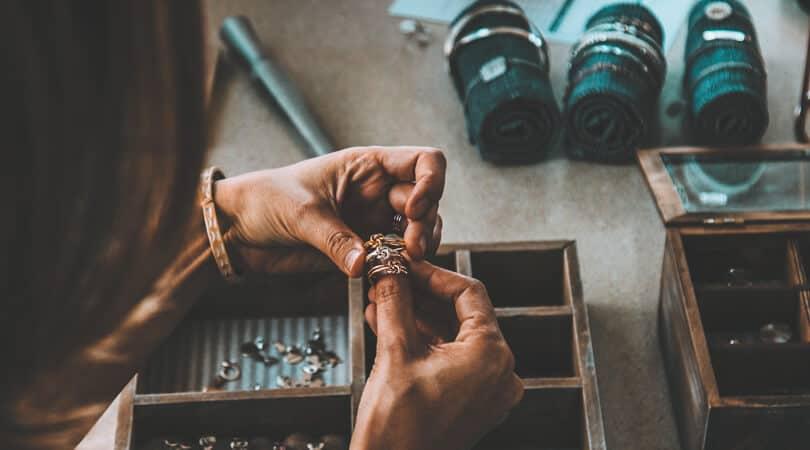 Women sorting silver jewelry