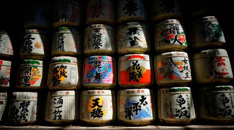 Bottles of sake sitting on each other