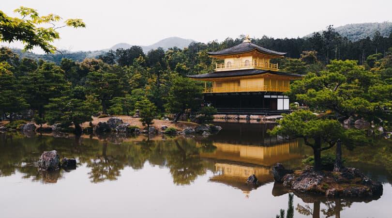 Golden temple near water in Japan