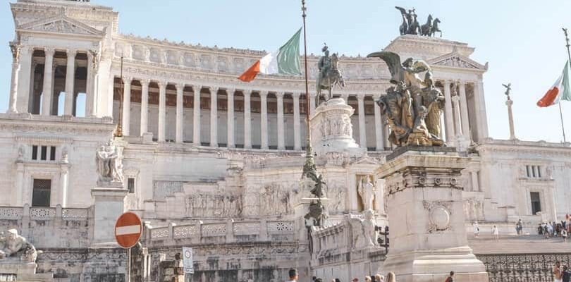 People standing next to Altar of Fatherland in Rome