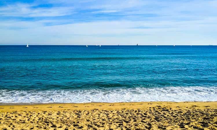 Looking at the sea at beach in Barcelona