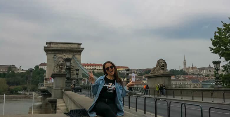 Girl sitting on Lion bridge in Budapest