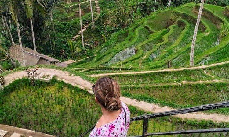 Girl walking down the stairs at Tegallalang rice terrace Bali